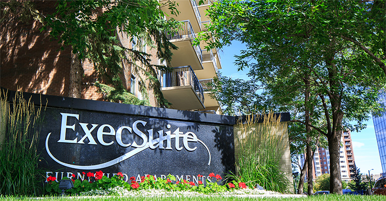 ExecSuite Furnished Apartments sign
